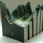 Landscapes carved into books (8 images)